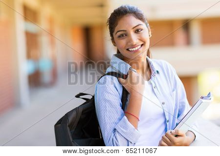 cheerful young indian college girl on campus