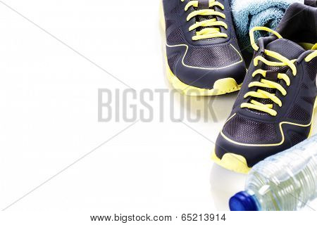 Sport shoes, measuring type and water on white background
