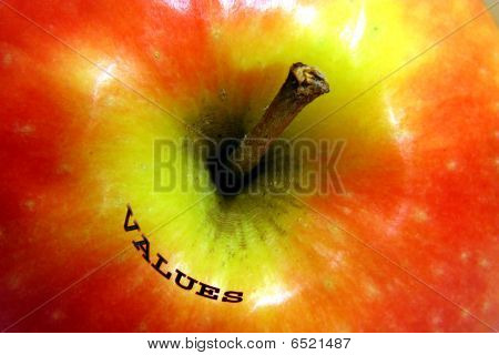 apple with value written on it