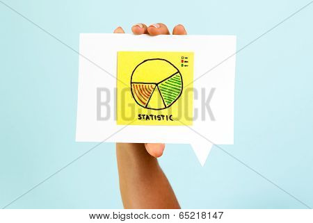 Hand showing business statistics report on speech bubble and blue background
