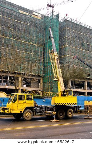 Telescopic Crane Are Lifting Heavy Weight On Construction Site.