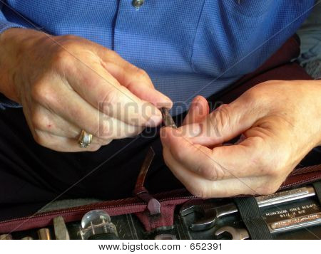 Elderly Man With Tools