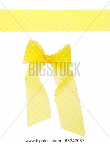 Yellow Semitransparent Dotted Ribbon With A Bow Isolated