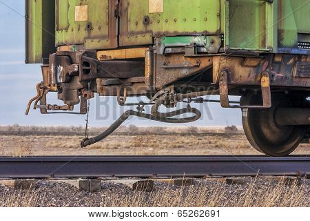 a rail car for livestock transportation or train end on a sidetrack in Colorado farmland