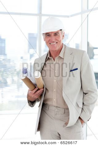Senior Architect With A Hardhat Holding Blueprints