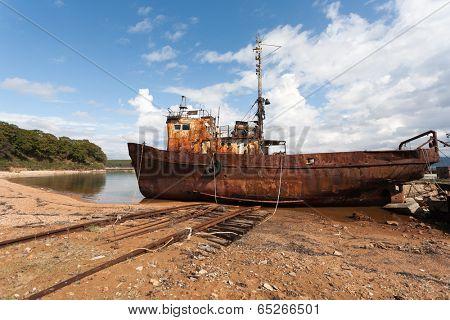 Fishing boat in the sea port in the old slip dock. poster