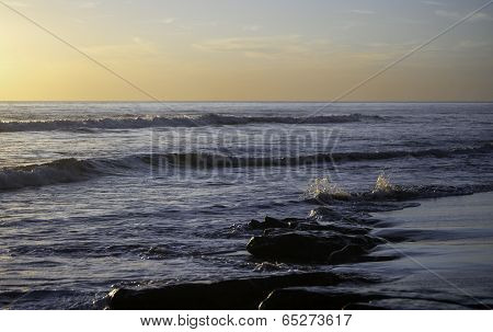 Rippling against the Shore