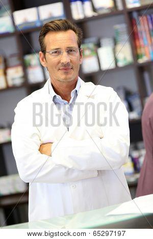 Portrait of smiling pharmacist with eyeglasses