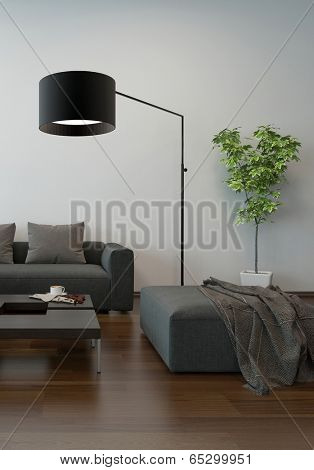 Living room interior in shades of grey with a modern upholstered lounge suite with an ottoman and freestanding standard lamp on a parquet floor