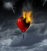Career Crisis and trouble ahead business concept with a businessman during a lightning and thunder storm flying up with a red hot air balloon that is on fire as a metaphor. poster