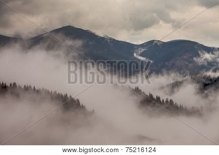Global Warming. Mountain Landscape. Clouds And Fog