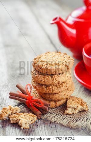 Homemade Cookies, Cinnamon Sticks, Red Teakettle And Tea Cup