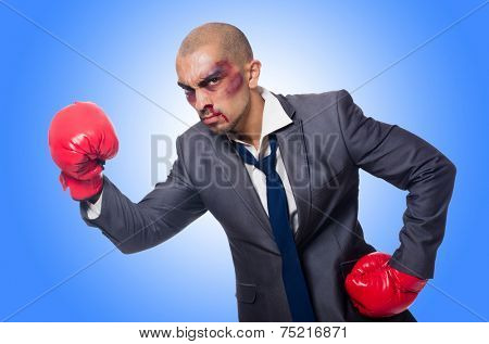 Badly beaten businessman with boxing gloves