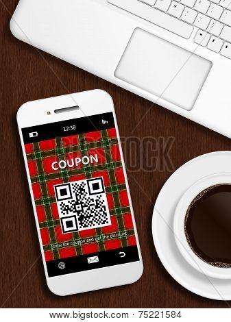 Mobile Phone With Christmas Coupon, Mug Of Coffee And Laptop Keybaord