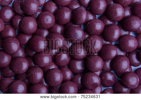 Background of coated purple candy