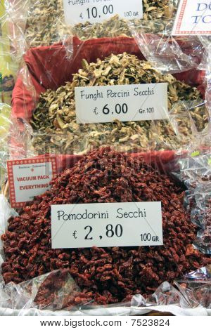 Dry tomatoes and fungi in an italian market