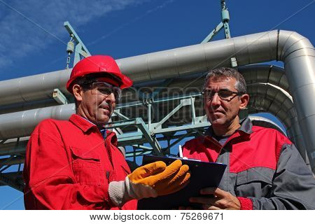 Engineer Signing A Document In Power Plant