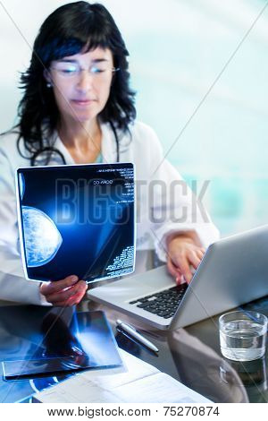 Female Doctor Analyzing  Mammogram X-ray.