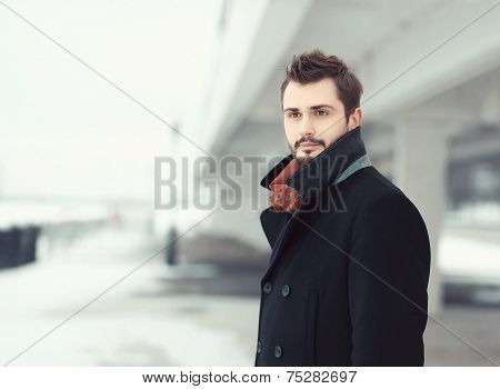 Vintage Photo Handsome Stylish Bearded Brunette Man In Black Coat Looks Away Outdoors
