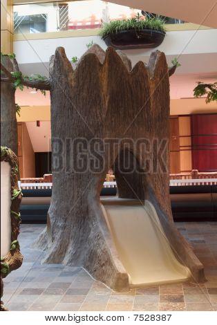 Child Tree Slide in Amusement Park