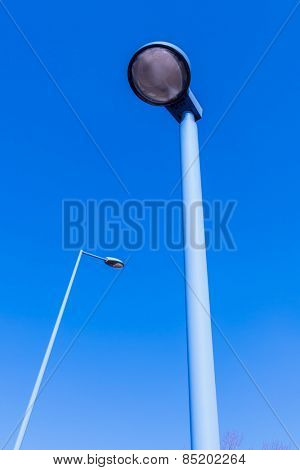 street lights in front of blue sky