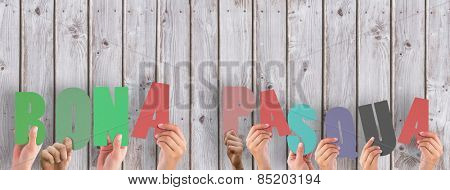 Hands holding up bona pasqua against wooden planks