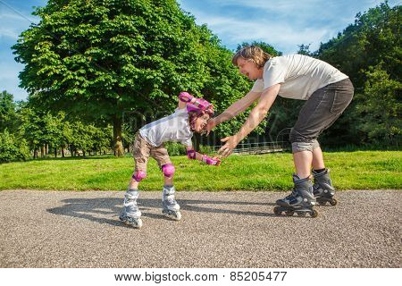 Summer sports: kid studying roller skating