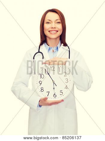 healthcare and medicine concept - smiling female doctor with wall clock and stethoscope