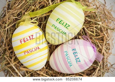 feliz pasqua against close up on three easter eggs