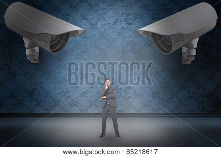Thinking businessman against dark grimy room