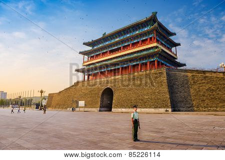 BEIJING, CHINA - JUNE 24, 2014: A soldier stands guard at Zhengyangmen Gatehouse in Tiananmen Square.