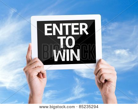 Tablet pc with text Enter to Win with sky background