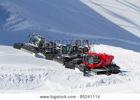 SOCHI, RUSSIA - MARCH 22, 2014: Ratraks, grooming machines, special snow vehicles in ski resort.