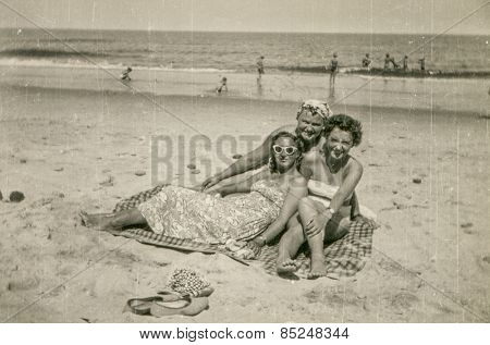 SOPOT, POLAND, CIRCA 1960's: Vintage photo of three women resting on beach