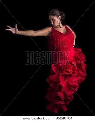 Flamenco Dancer Backs Red Dress And Hands Crossed Up On Black Background