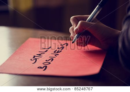 Conceptual Handwritten Small Business On A Paper