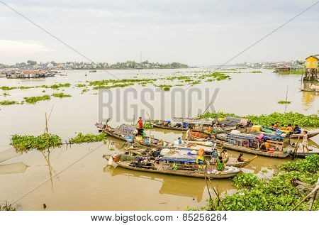 CHAU DOC, VIETNAM - JANUARY 2, 2013:  Rural life: Local fishermen' families living on their boats in port on Hau River (Bassac River) in Chau Doc in Mekong Delta