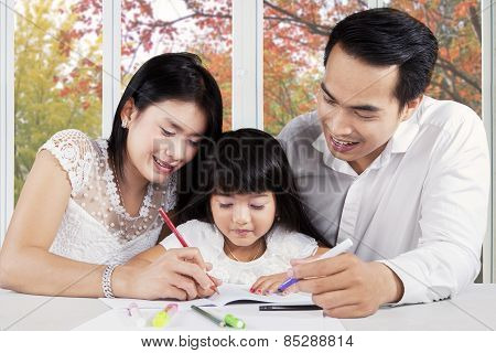 Beautiful Family Doing Schools Assignment