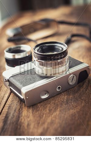 Old Retro Camera On Vintage Wooden Boards