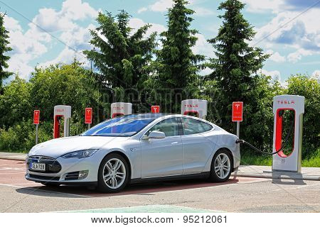 Charging Tesla Model S Battery At Tesla Supercharger Station
