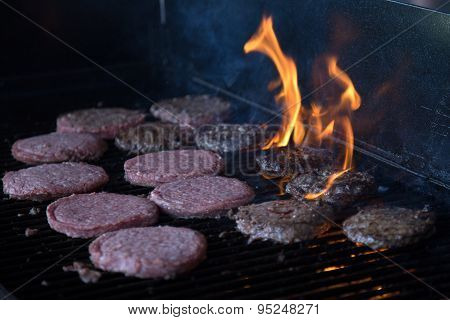 Hamburgers on Grill with Flames