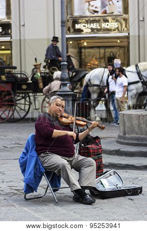 Artist Playing A Fiddle On Piazza Della Repubblica In Florence