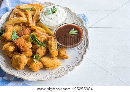 Served Chicken Nuggets And French Fries