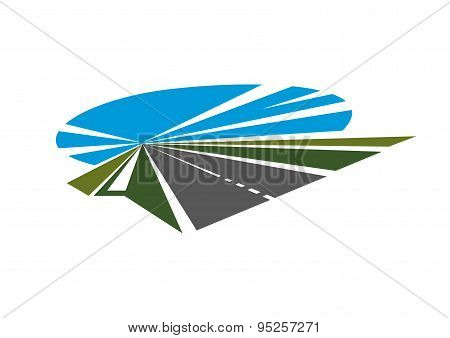 Highway with green roadsides and blue sky