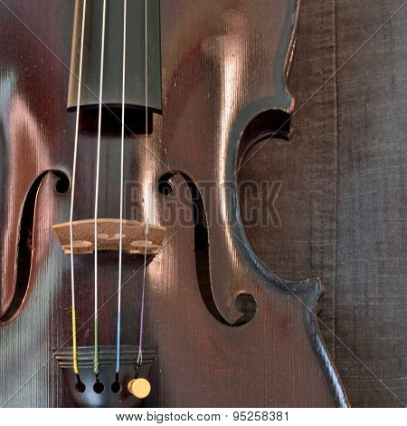Antique Violin Closeup Against Gray Fabric Background, Square