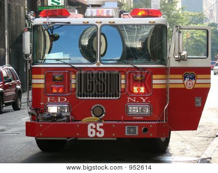 fire engine parked with door open and lights flashing poster