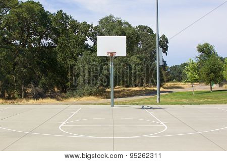 Basketball Hoop With White Backboard And Court