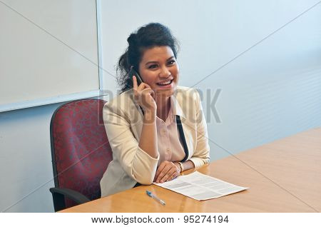 Business woman call to inquire more details and talk over phone
