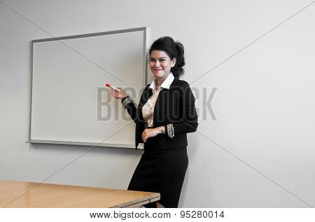 Business woman present with draw board on white background and laughting.