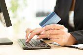Business Woman holding Credit Card for Online Payment poster